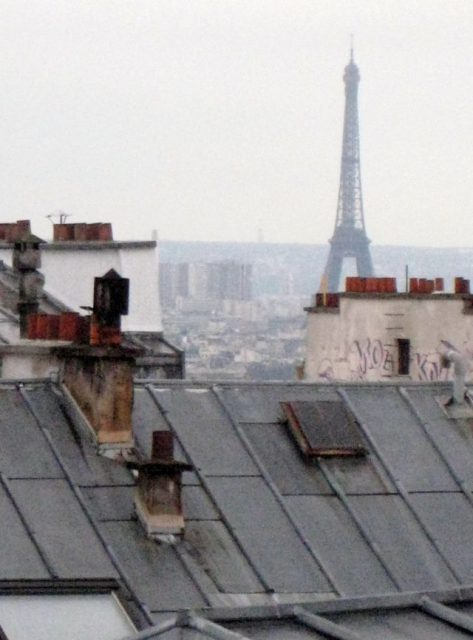 The Eiffel Tower seen over the rooftops of Montmartre, Paris