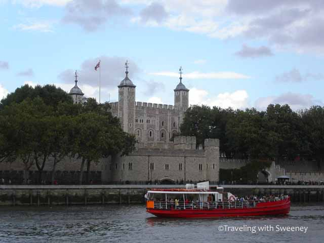 A boat passes the Tower of London on the Thames River in London