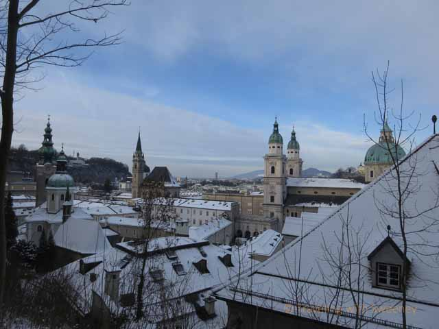Church towers and snowy rooftops of Salzburg, Austria