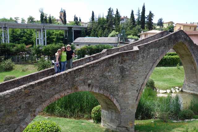 Catherine Sweeney with Teresa Keane and Alessandra Catania on the San Donato Bridge in Modigliana, Italy