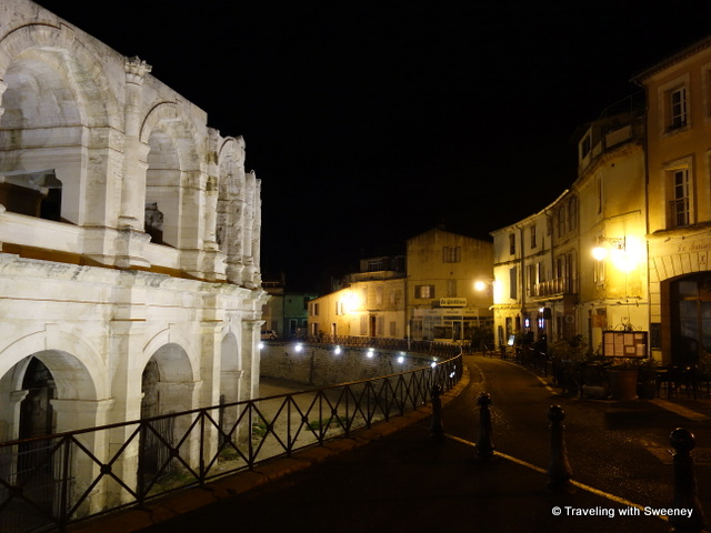 Roman arena and quiet street in Arles at night