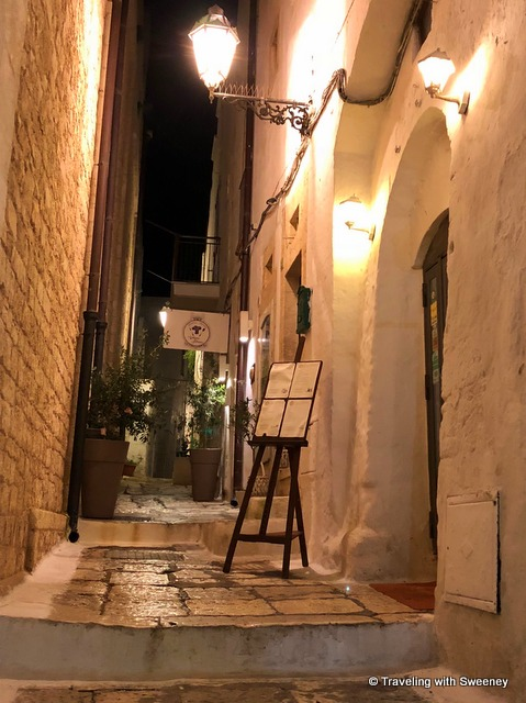 Up a few steps to Osteria Monacelle for dinner in Ostuni, Italy