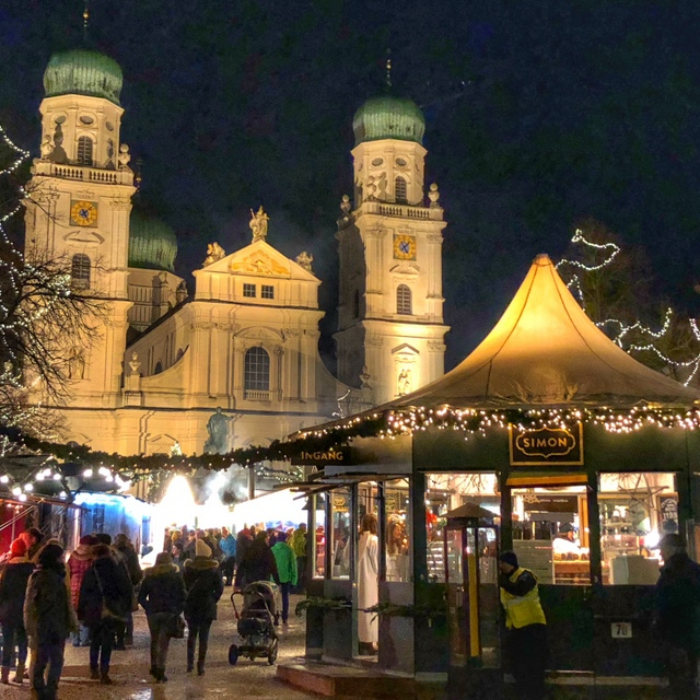 St. Stephen's Cathedral towers over the Christmas Market of Passau, Germany