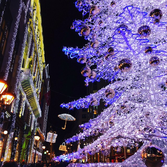 Sparkling Christmas tree and other decorations on street in Budapest, Hungary