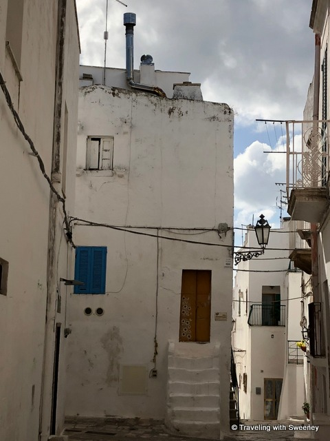 Doors and shutters add color touches to the neighborhood in Ostuni, Italy