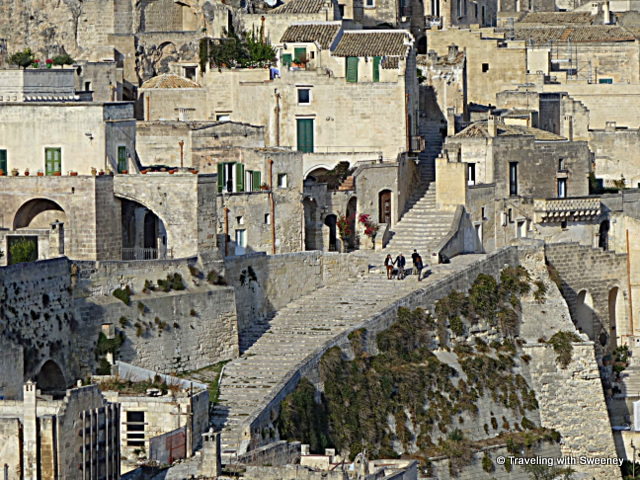 View from panoramic viewpoint in Matera --- Visitors exploring Sasso Caveoso