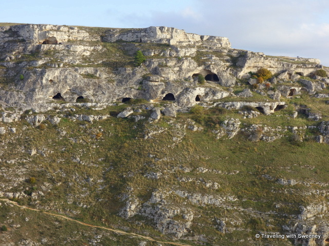 Ancient natural caves dot the hillside of the Murgia Timone across the ravine from the Sassi di Matera, Italy
