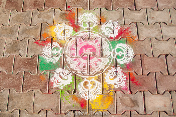 Pavement painting, rangoli, are in front of many homes in Aurangabad,, India -- Photo by Anita's Feast