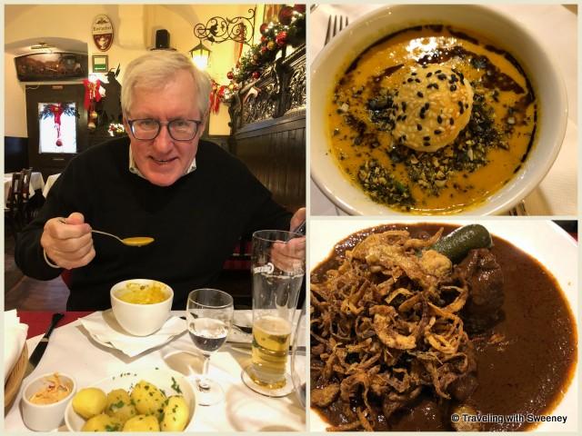 Pumpkin soup and beef goulash at Griechenbeisl restaurant in Vienna, Austria