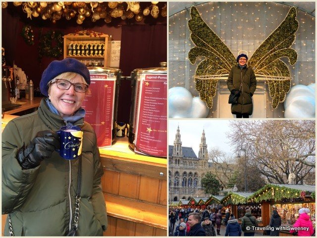 Toasting with glühwein and posing as an angel, at the festive Rathausplatz Christmas Market in Vienna, Austria