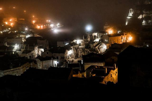 Matera takes on a mysterious glow at night -- Photo by Federica Donadi