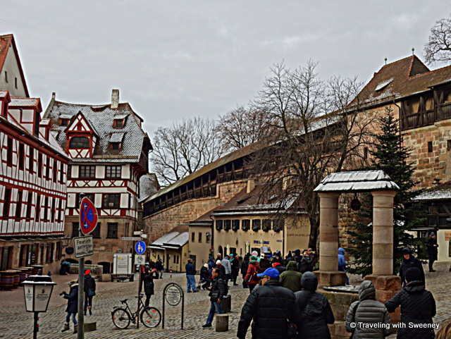 Medieval architecture in a square below the stone walls of the Imperial Castle in Nuremberg, Germany