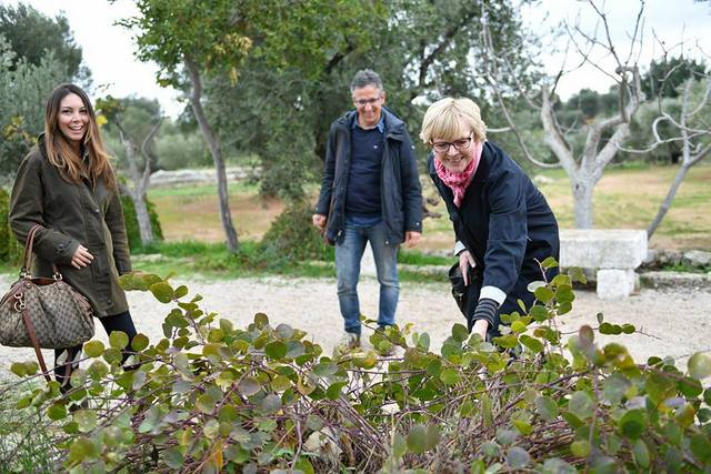 Examining the flora at Antica Brancati in Dune Costiere Park in Ostuni, Puglia, Italy -- Photo by Federica Donadi