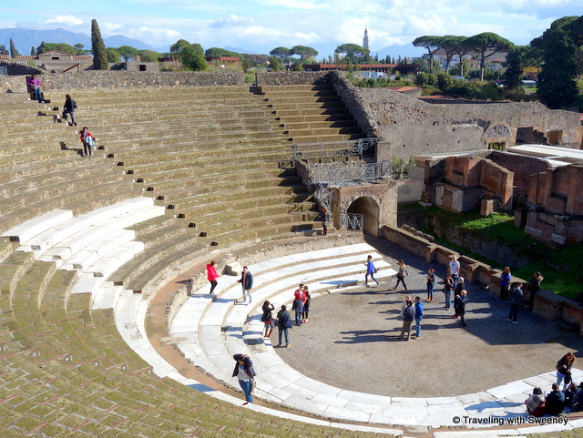 Tourists exploring the Pompeii Amphitheater -- a day trip from Rome