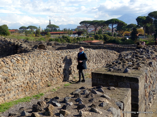Catherine of Traveling with Sweeney walking through the ruins of Pompeii, a UNESCO World Heritage Site in Italy --- a day trip from Rome
