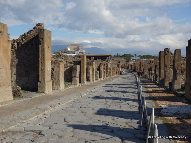 Wide paved street in the ruins of Pompeii in Italy -- a day trip from Rome