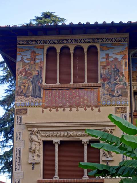 Palms and frescos of the Fairy Cottages in Quartiere Coppede in Rome, Italy
