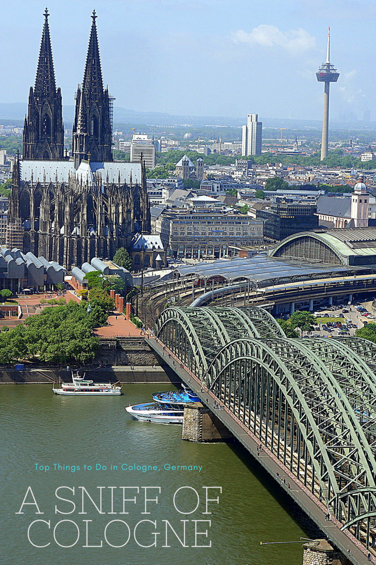 Gorgeous view of Cologne, Germany from the KölnTriangle -- Kölner Dom, Central Station and Hohenzollen Bridge. Top things to do in Cologne, Germany on a day trip. There's history, architecture, food, festivals, beer and the unexpected. #Köln #Germany