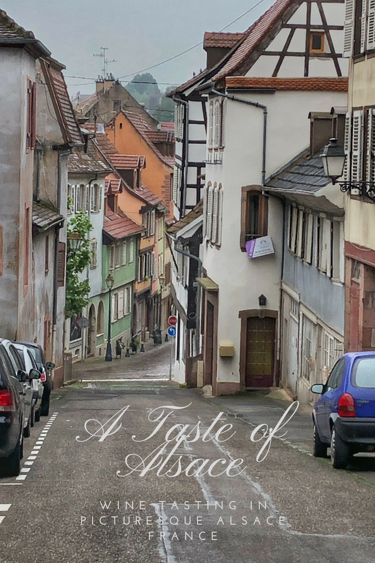 Picturesque scene of a steep, narrow street and its half-timbered houses on a walking tour and #wine tasting in the medieval town of Barr in the #Alsace region of #France
