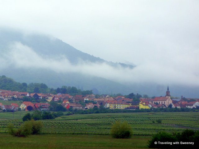 Low-lying clouds above a village in Alsace, France