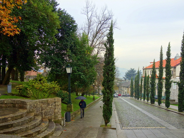Peaceful Guimaraes -- a quiet lane leads from the castle to the city center, Portugal