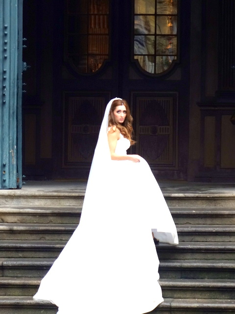 A beautiful bride on the church steps in Guimaraes, Portugal
