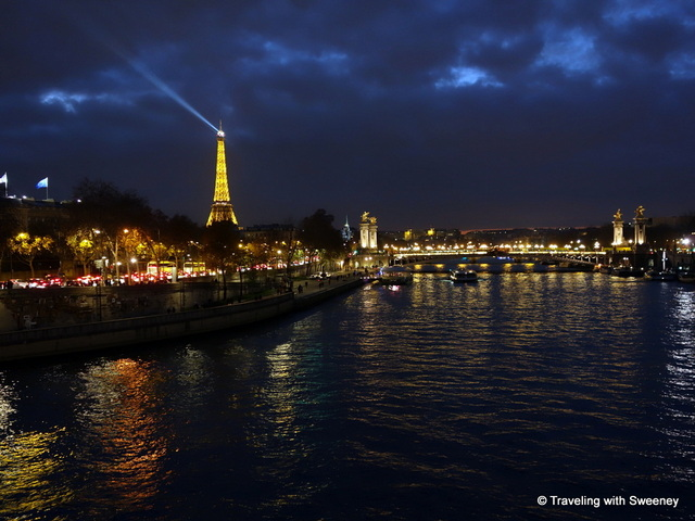 The Eiffel Tower across the Seine River at night, Paris, France