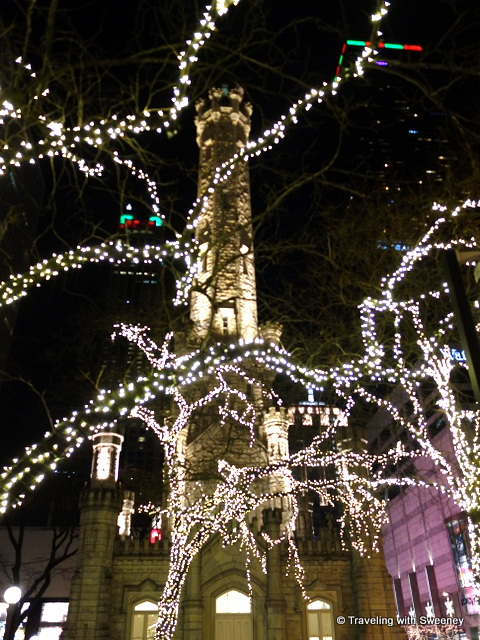 Sparkling lights adorn trees around the historic water tower, Chicago at Christmas