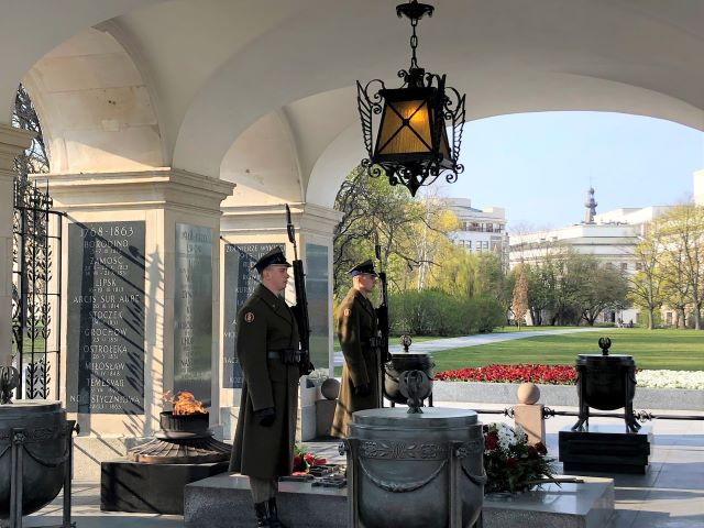 Soldiers stand guard at the Tomb of the Unknown Soldier in Saxon Gardens in Warsaw, Poland