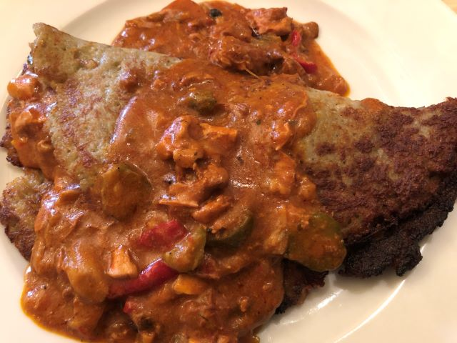 Hearty Polish food -- Potato pancake with chicken goulash served at Restauracja Bazyiszek in Warsaw, Poland