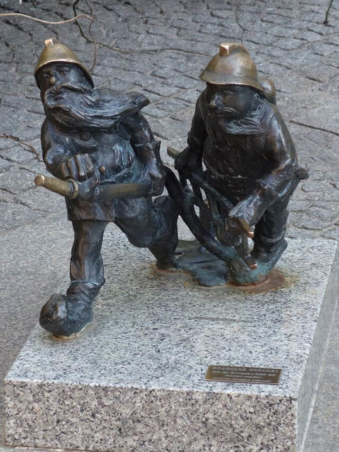 Firemen dwarf statues on the main square in Wroclaw, Poland