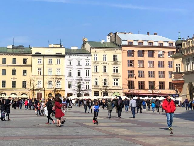 Rynek Glowny (Krakow's Main Market) on a Sunday afternoon in the spring, Krakow, Poland