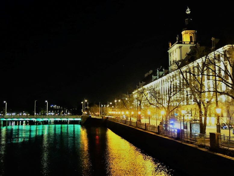 NIght view of the main building of the University or Wroclaw from a bridge on the Oder River, Wroclaw, Poland