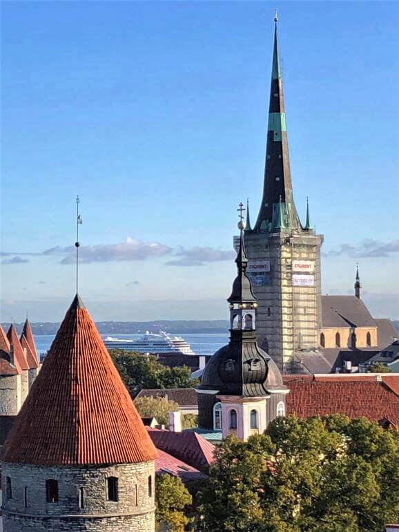 The Viking Jupiter at port beyond the rooftops and spires of Tallinn, Estonia