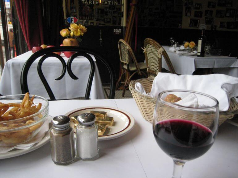 A glass of Bordeaux and frites at Lucien on the Lower East Side of New York City