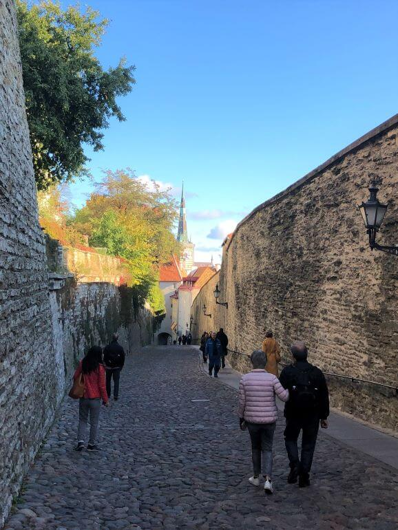 Walking along old city walls from Upper Town to Lower Town in Old Town, Tallinn, Estonia