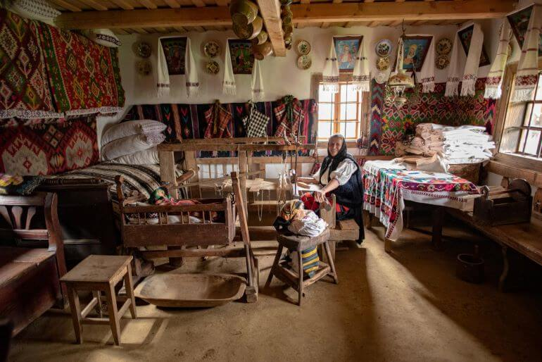 Romanian woman in her home -- Photo by Barbara Nelson