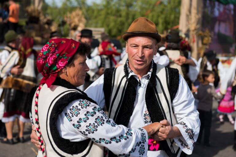 Dancers wearing traditional dress in Romania -- Photo by Barbara Nelson