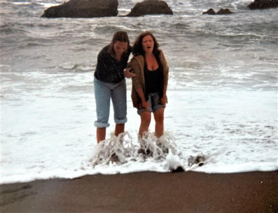 Playing in the surf in the Pacific Ocean along the Sonoma coast of California