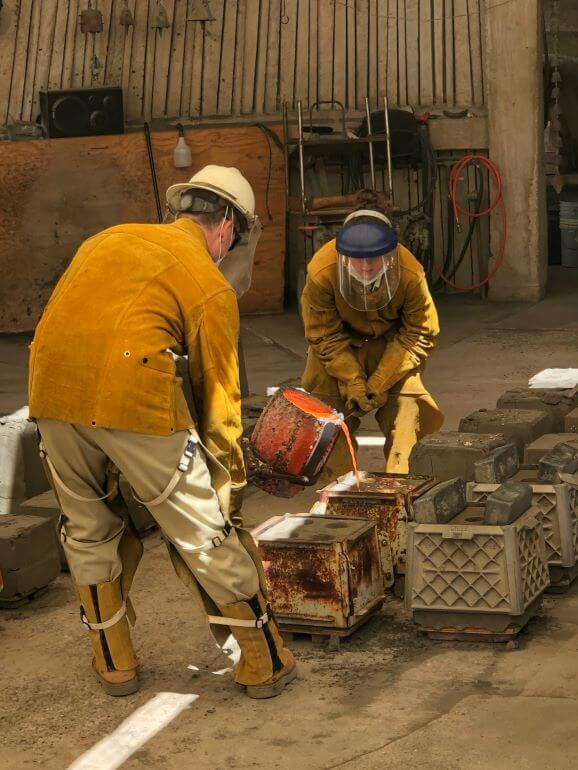 Molten bronze being poured into molds for bells at Cosanti Originals in Paradise Valley, AZ