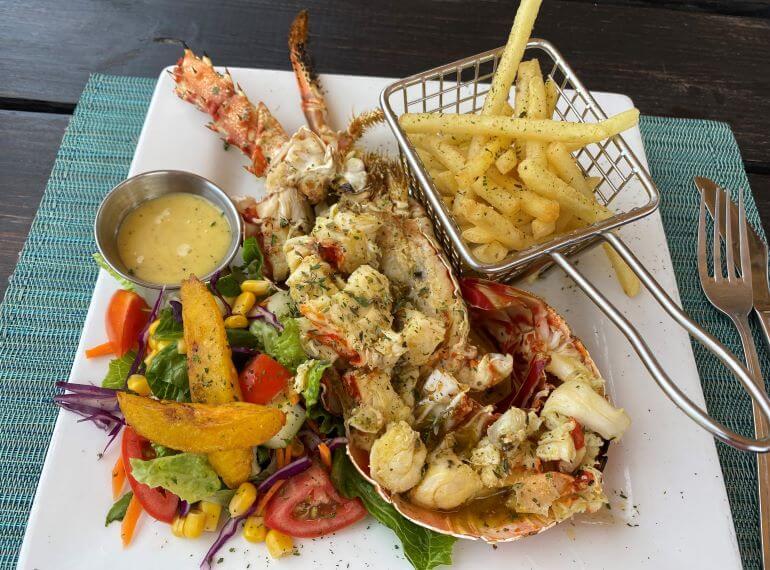 Lobster and fries at Beach Bum Bar on Half Moon Beach in Antigua