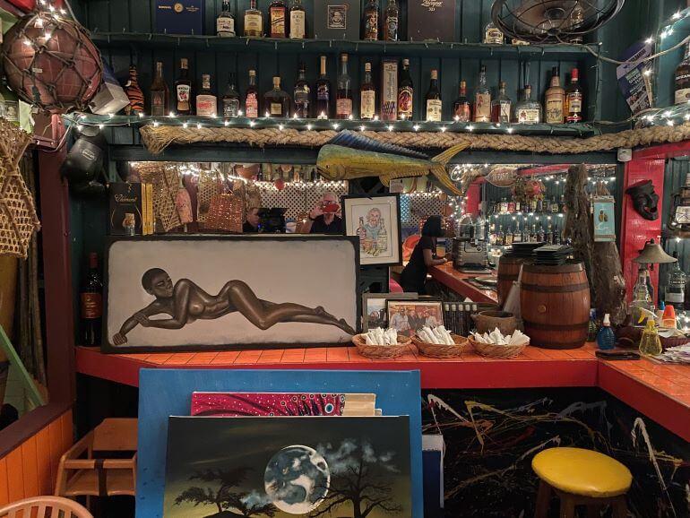 Papa Zouk rum bar and paintings by Bert Kirchner -- St. John's, Antigua